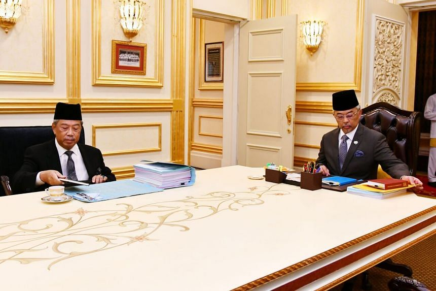 Malaysia Prime Minister Muhyiddin Yassin (left) and Malaysia's King, Sultan Abdullah Sultan Ahmad Shah are pictured prior to their meeting at the National Palace in Kuala Lumpur on Oct 28, 2020.