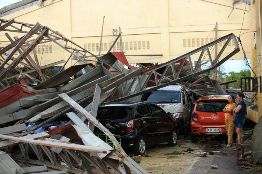 Cars damaged after a gymnasium collapsed at the height of super Typhoon Goni after it hit Tabaco, Albay, in Manila, on Nov 1, 2020.