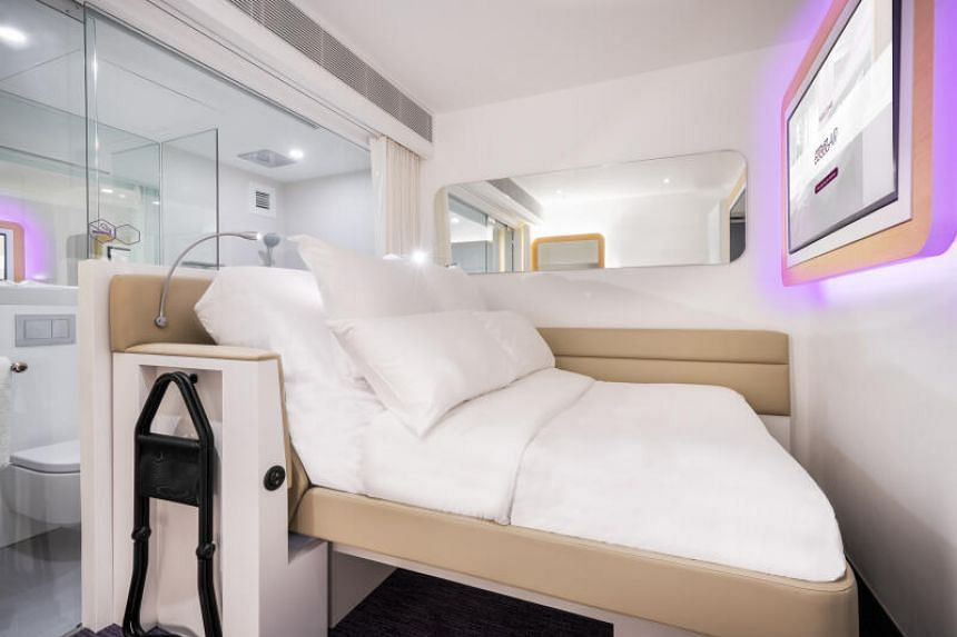 The pristine white rooms at Yotelair are designed like plushly compact first-class airline cabins.