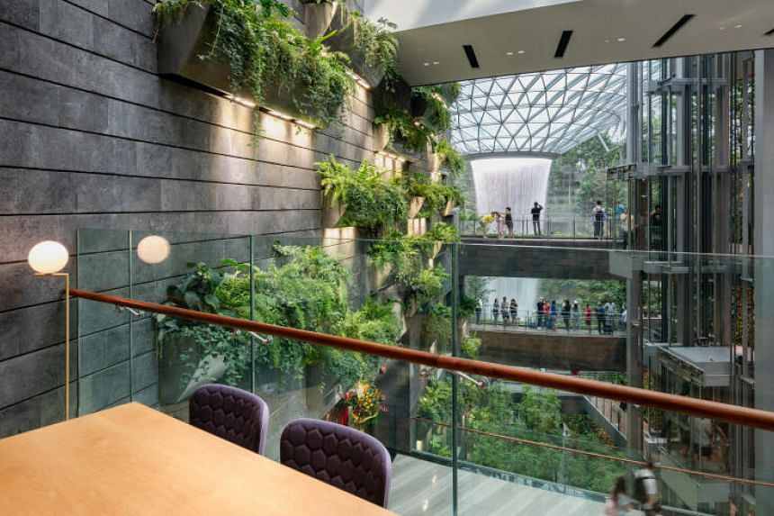 The lounge at Yotelair with a 24-hour view of the Rain Vortex waterfall.