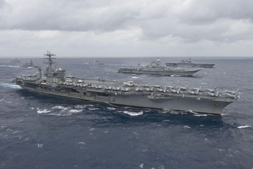 The aircraft carrier USS Nimitz in the Bay of Bengal as part of Exercise Malabar 2017.