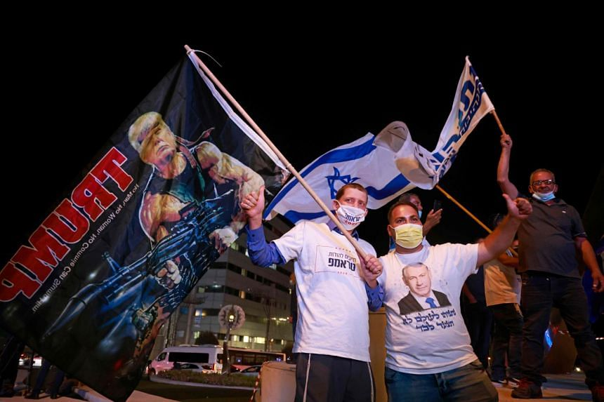 Israeli Right wing Likud party affiliates and supporters of US President Donald Trump attend a pre-election rally in the Israeli city of Beit Shemesh, on Nov 2, 2020.
