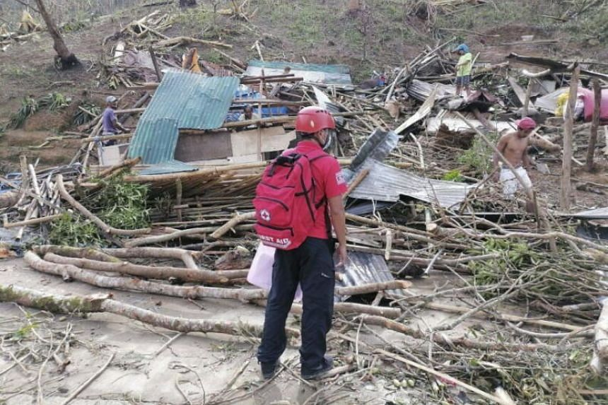 A Red Cross responder surveying areas affected by Typhoon Goni, in Catanduanes province, the Philippines, on Nov 3, 2020.