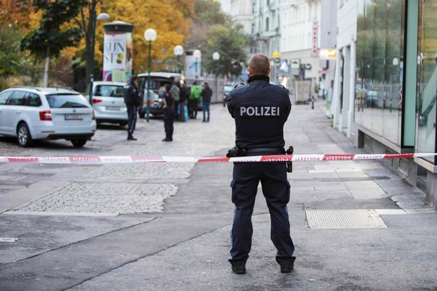 Austrian police guarding the site of a shooting, at Morzinplatz in Vienna, on Nov 3, 2020.