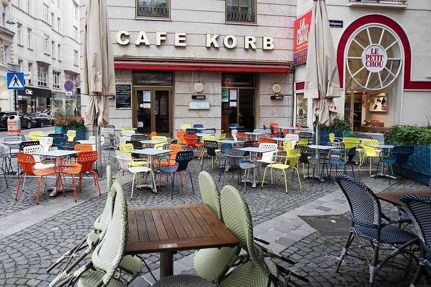 A shuttered restaurant in central Athens yesterday, after Greece announced a partial lockdown in the capital and other major cities.