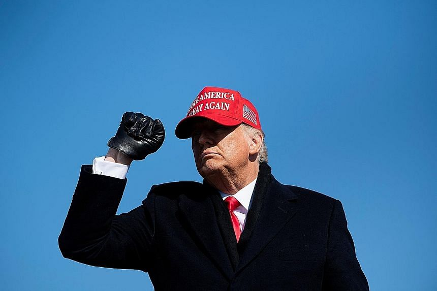 Democratic presidential nominee Joe Biden at a drive-in campaign rally in Pittsburgh, Pennsylvania, on Monday. He had slammed Mr Donald Trump's divisive presidency and promised to get the pandemic under control. Mr Donald Trump after speaking at a ra