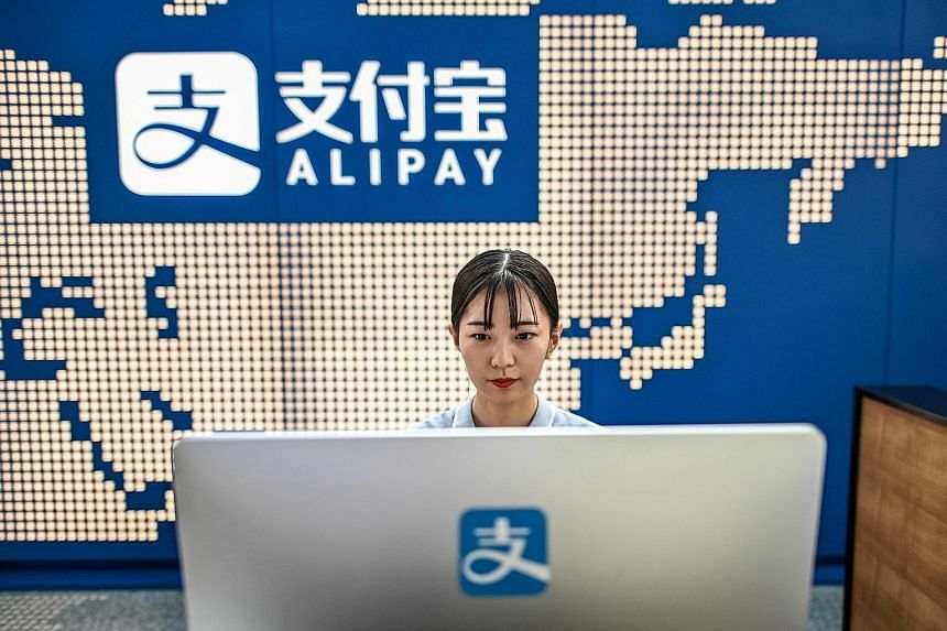 Beijing has become uneasy with banks heavily using micro-lenders or third-party technology platforms like Ant (above) - which launched the payment app Alipay - for underwriting consumer loans, amid fears of rising defaults and deteriorating asset qua