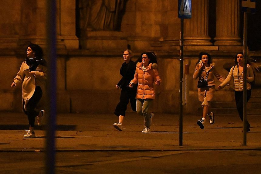 Police body-searching a man at Mariahilfer Strasse in central Vienna on Monday, following the shooting near a synagogue. PHOTO: AGENCE FRANCE-PRESSE People running away from the area near the Vienna State Opera in the city centre on Monday, following