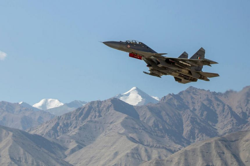 An Indian fighter plane flies over a mountain range in Leh, in the Ladakh region, September 15, 2020. Many parts of Ladakh's undemarcated border between the China and India are the subject of dispute.