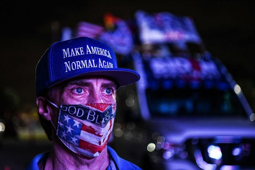 A supporter of the Democratic party during a watch party in Miami, Florida, on Nov 3, 2020.