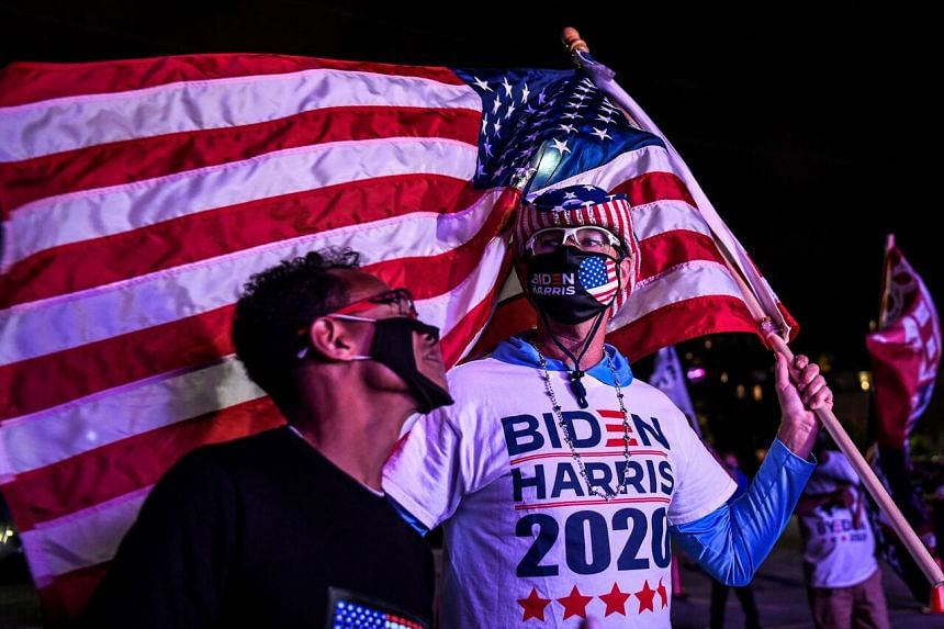 Supporters of Democratic presidential candidate Joe Biden during a watch party in Miami, Florida, on Nov 3, 2020.