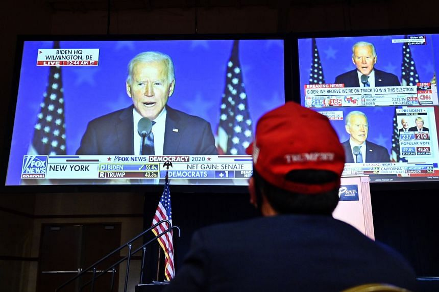 A supporter of US President Donald Trump watching a broadcast of Democratic presidential candidate Joe Biden's speech in Las Vegas, Nevada, on Nov 3, 2020.