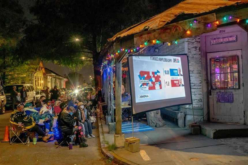 People watching the election results at a bar in New Orleans, Louisiana, on Nov 3, 2020.