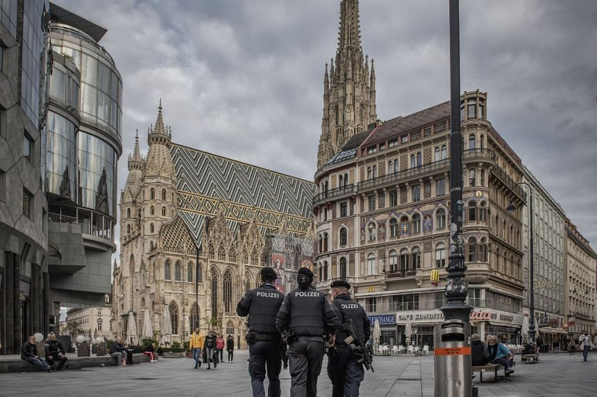 Police patrol the scene of the mass shooting in Vienna.
