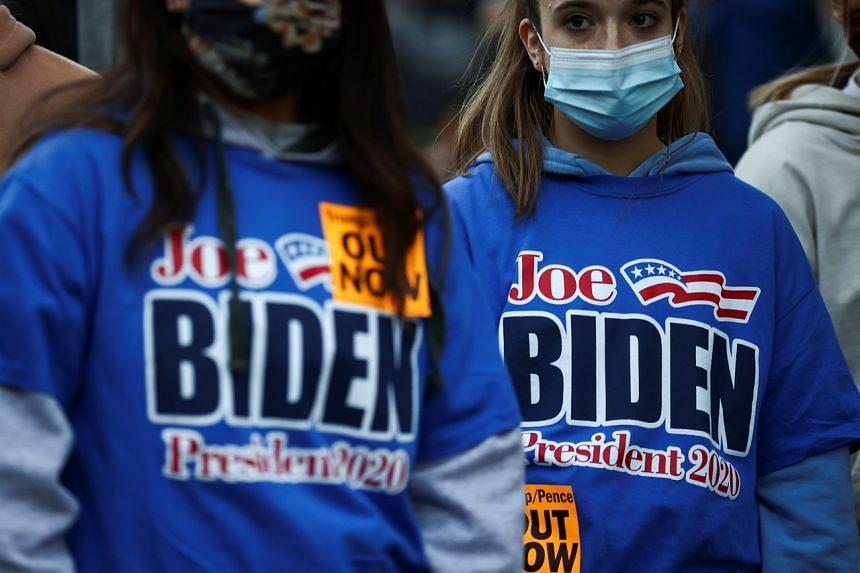 Supporters of US Democratic presidential candidate Joe Biden gather in Washington on Nov 3, 2020.