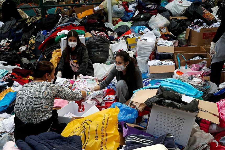 Clothing being collected and sorted out for survivors on Tuesday, after the earthquake struck the Aegean Sea, in the coastal province of Izmir last Friday. The quake injured 1,035 people in the city.