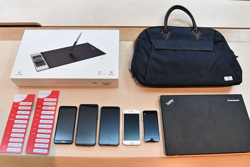 Evidence seized during a police raid in Bukit Timah to arrest people allegedly involved in a series of cheating cases.