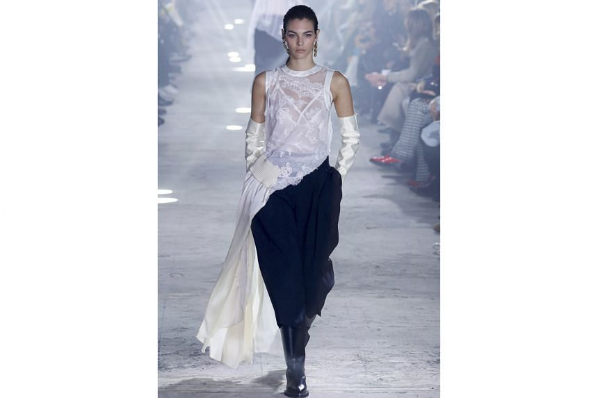 IN BLACK AND WHITE: Designer Chitose Abe's Sacai collection included a white lace blouse with a trailing one-sided silk train and was paired with satin opera gloves and slouchy black tuxedo trousers.