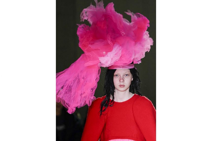 A HEAD FOR STYLE: Giant headdresses complement the hot pink and bulbous looks at Comme des Garcons.