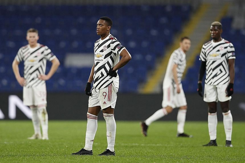 Manchester United's Anthony Martial (centre), Paul Pogba (right) and teammates looking dejected during the 2-1 Champions League defeat by Istanbul Basaksehir on Wednesday.