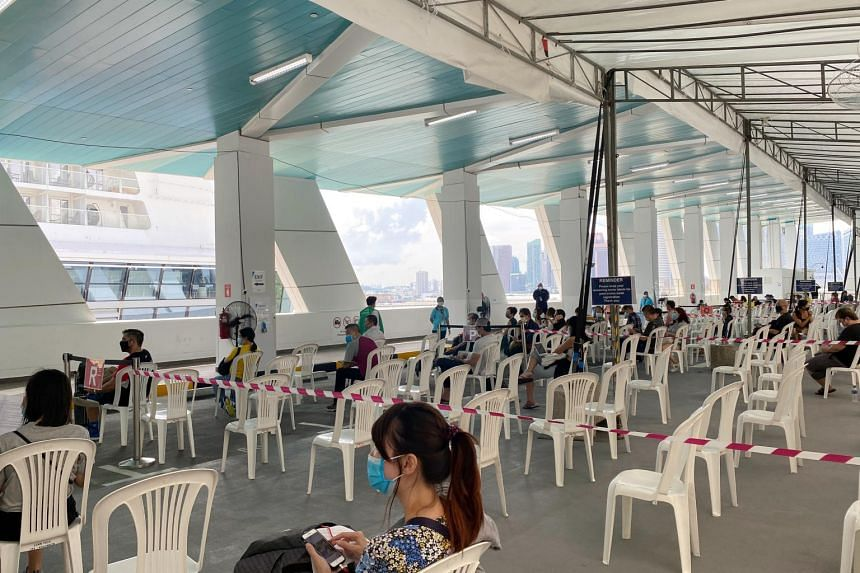 Passengers of the World Dream cruise waiting at designated colour zones for the rapid antigen test results at Marina Bay Cruise Centre on Nov 6, 2020.