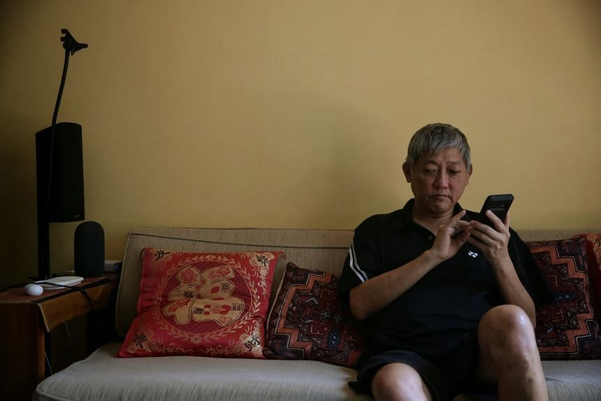 Visually-handicapped Mr Dennis Teo uses various tech tools and apps that help him.