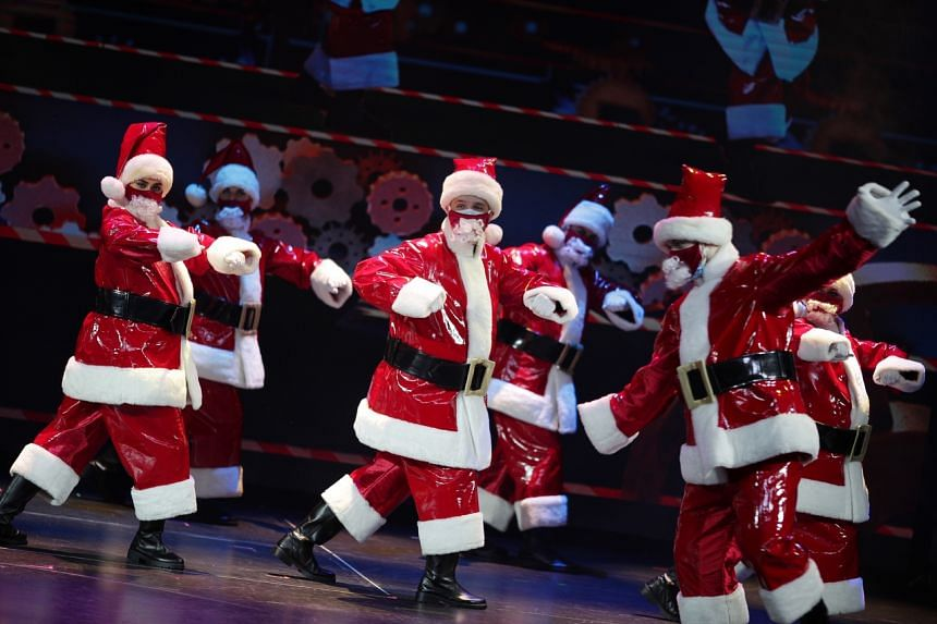 Entertainers performing a Christmas-themed show on board the World Dream, on Nov 6, 2020.