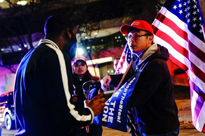 Supporters of US President Donald Trump argue with Black Lives Matter counter-protesters in Milwaukee, Wisconsin, on Nov 5, 2020.