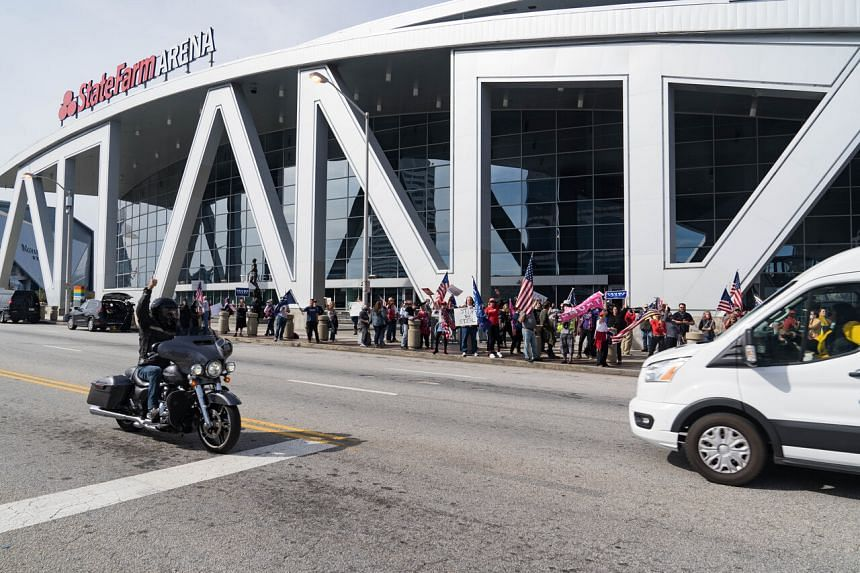 Supporters of US President Donald Trump protest outside State Farm Arena as ballots continue to be counted inside on Nov 5, 2020, in Atlanta, Georgia.