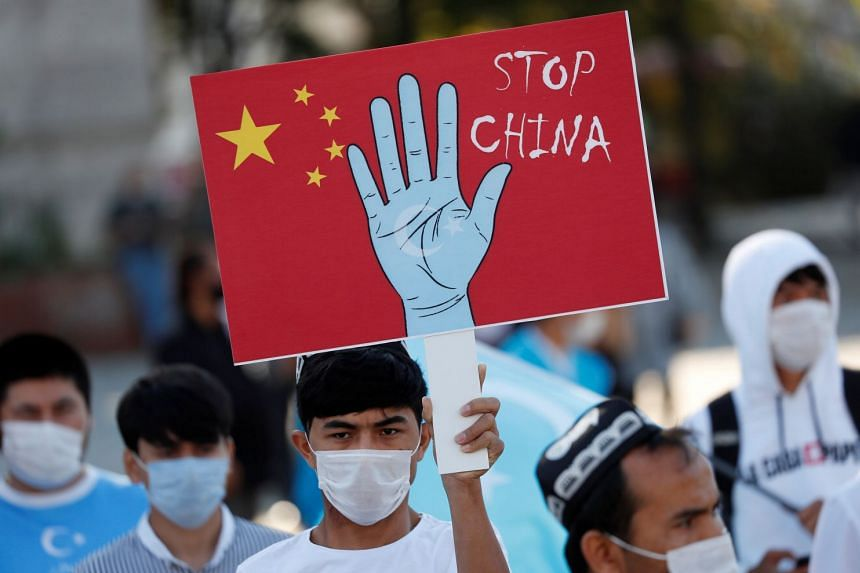Ethnic Uighur demonstrators take part in a protest against China in Istanbul, Turkey.