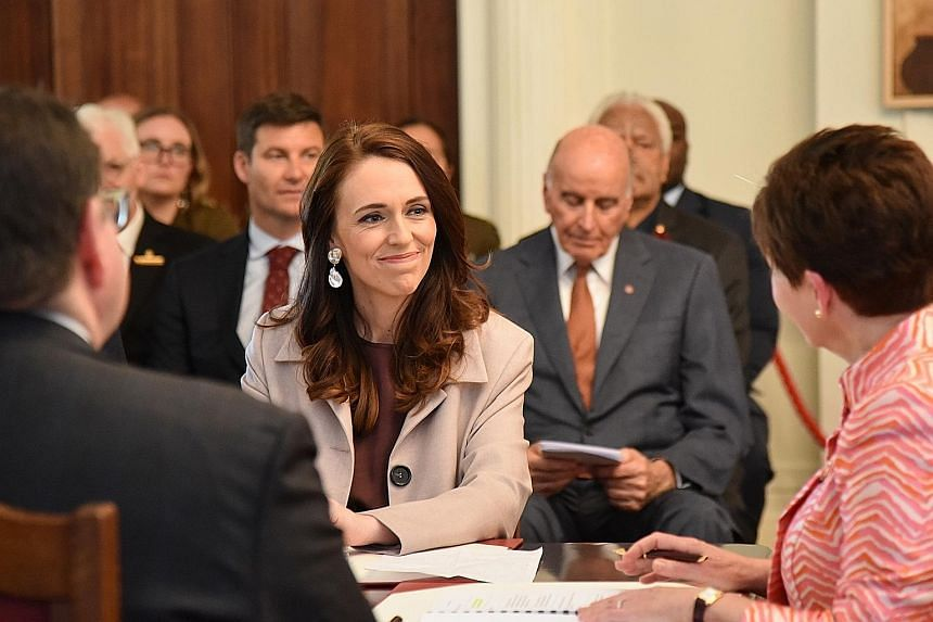 Ms Jacinda Ardern (centre) accepting her formal appointment as New Zealand's Prime Minister from Governor-General Patsy Reddy (right) in a ceremony yesterday at the Government House in Wellington. PHOTO: EPA-EFE