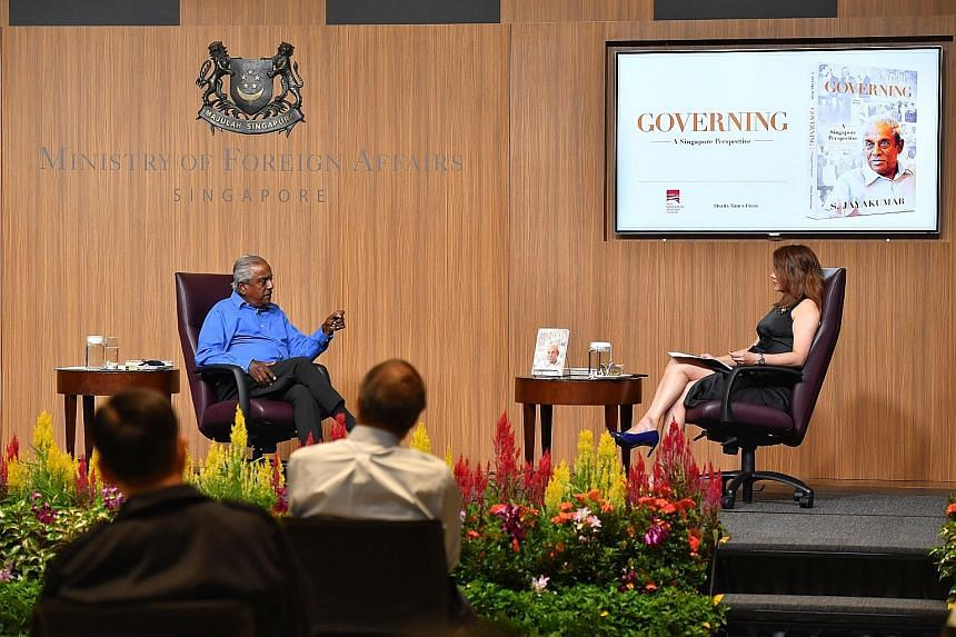 Professor S. Jayakumar speaking at the launch of his new book at the Ministry of Foreign Affairs yesterday, with Money FM 89.3 presenter Michelle Martin moderating the session. He said that when he began writing Governing: A Singapore Perspective, it