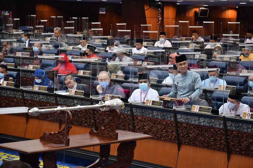 Malaysian Finance Minister Tengku Zafrul Aziz (front 2-R) presents the 2021 budget at Parliament House in Kuala Lumpur, Malaysia, on Nov 6, 2020.