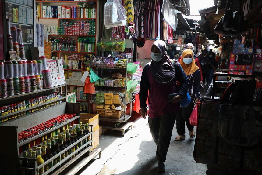 Shoppers wearing masks browsing at a market in Kuala Lumpur, amid the Covid-19 outbreak, on Nov 6, 2020.