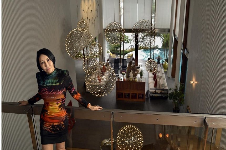 Ms Mathilda Koh, seen in her current home at Sentosa Cove, is confident that prices in the posh seaside enclave will recover.