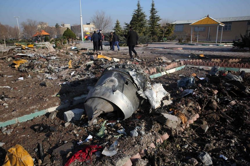 In a photo taken on Jan 8, 2020, rescue teams work amidst debris after a Ukrainian plane carrying 176 passengers crashed near Imam Khomeini airport.
