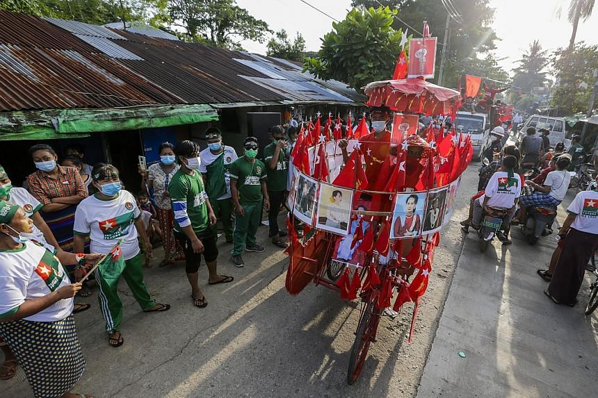 Union Solidarity and Development Party supporters singing their campaign song during a campaign event outside Yangon on Friday, two days before Myanmar's election.