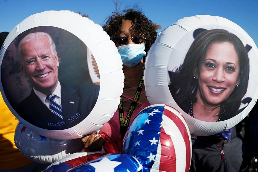 Balloons with the faces of US Democratic presidential nominee Joe Biden and vice-presidential candidate Kamala Harris in Wilmington, Delaware on Nov 7, 2020.