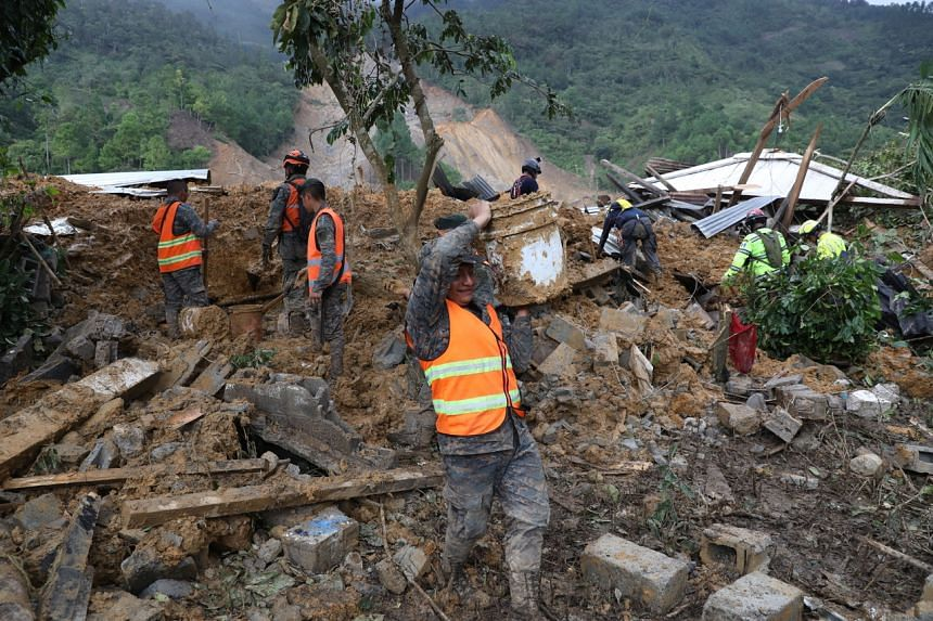 Rescue workers search for victims in the disaster area in the Queja village of Guatemala on Nov 7, 2020.