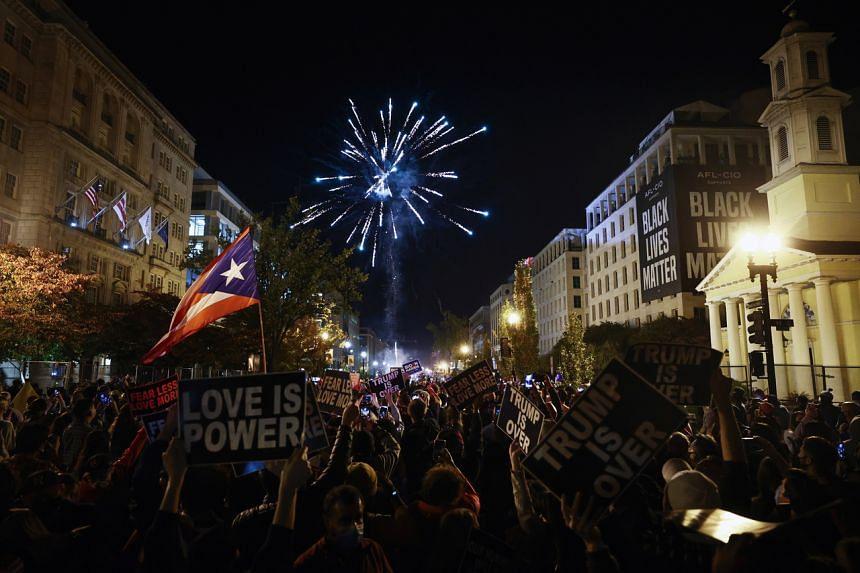 People celebrate in Washington on Nov 7, 2020.
