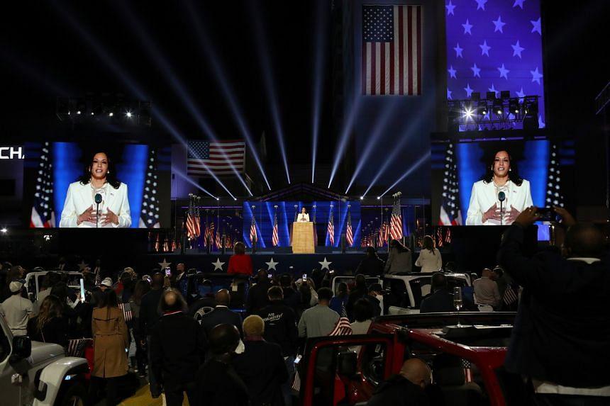 People watch US vice-president elect Kamala Harris in Wilmington, Delaware, on Nov 7, 2020.