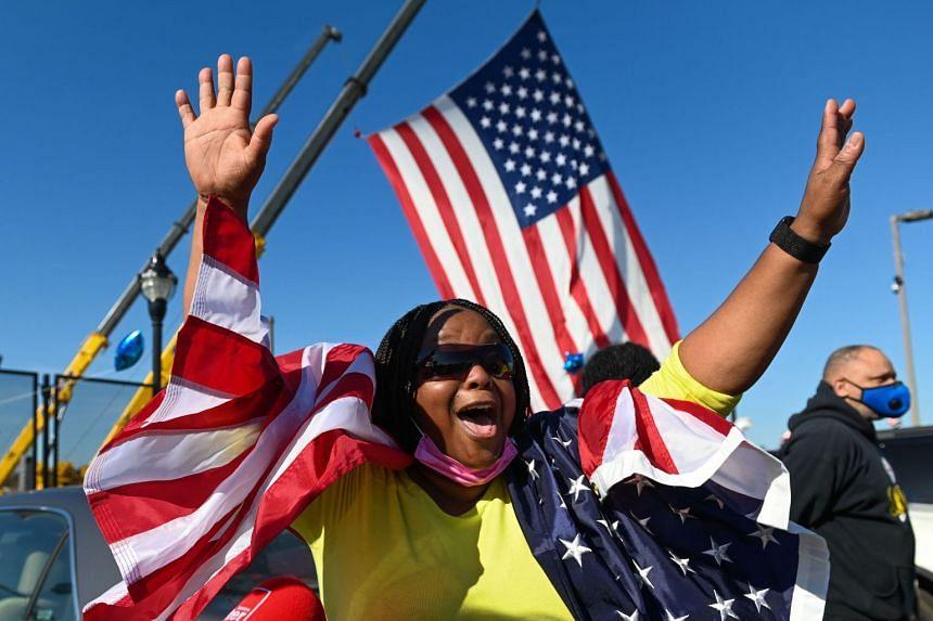 Biden supporter Yei Boayue celebrates in Wilmington, Delaware.