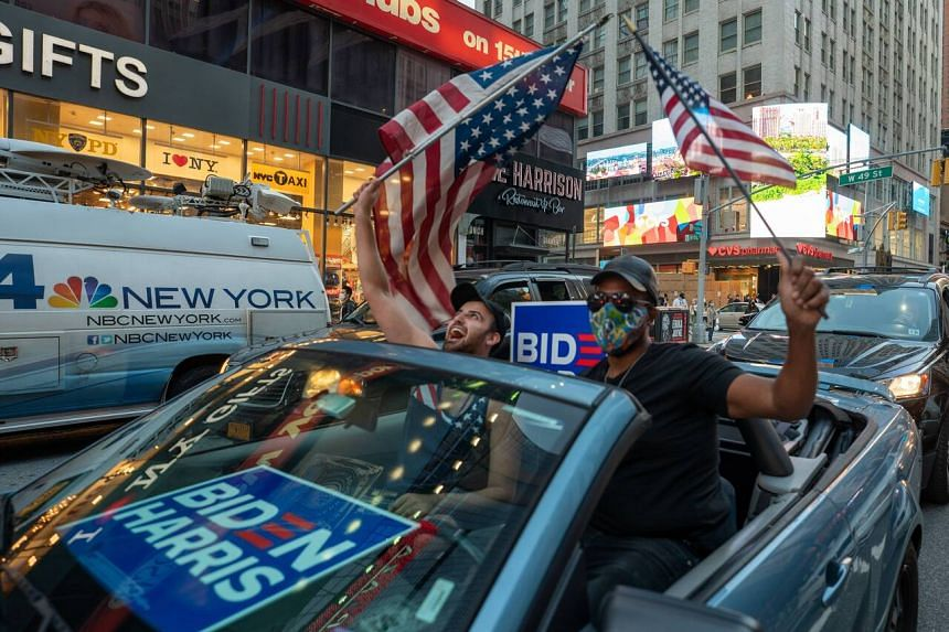 Biden supporters celebrate in New York City's Times Square on Nov 7, 2020.