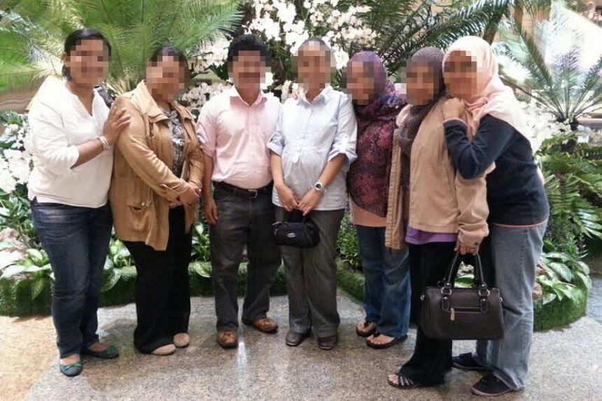 The man accused of heading an all-female group with deviant religious practices poses with some of his female followers.