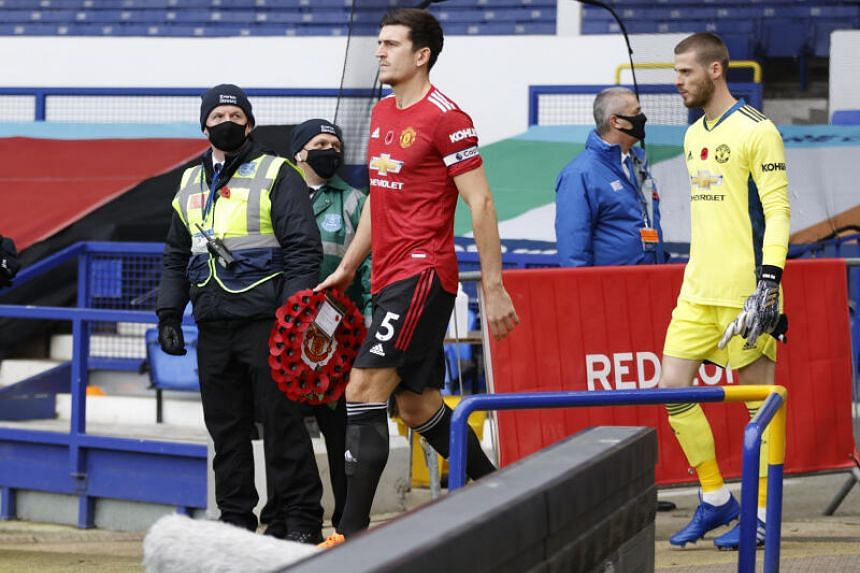 Manchester United's Harry Maguire leads his team out before the match against Everton at Goodison Park on Nov 7, 2020.
