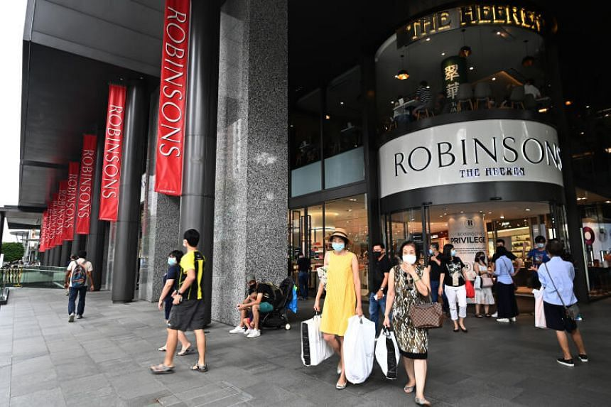 Shoppers leaving Robinsons at The Heeren on Oct 31, 2020.