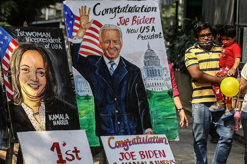 A painting in the Indian city of Mumbai yesterday showing the US' President-elect Joe Biden and his second-in-command Kamala Harris. Most government leaders in Asia have expressed hopes of strengthening ties with Mr Biden's administration and politic