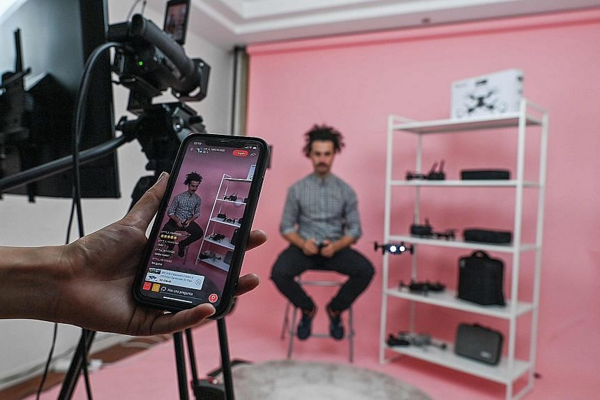 Mr Lalo Lopez at a studio in Shanghai where he usually live-streams to offer products on an AliExpress channel in his home country Spain. Chinese agencies are training foreign hosts in China and recruiting influencers abroad, in hopes of hooking onto