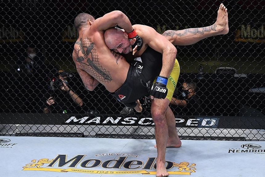 Glover Teixeira (yellow shorts) wants a title fight for the first time in over six years, after submitting Brazilian compatriot Thiago Santos via a rear-naked choke in the main event of UFC Fight Night in Las Vegas on Saturday. The 41-year-old came b