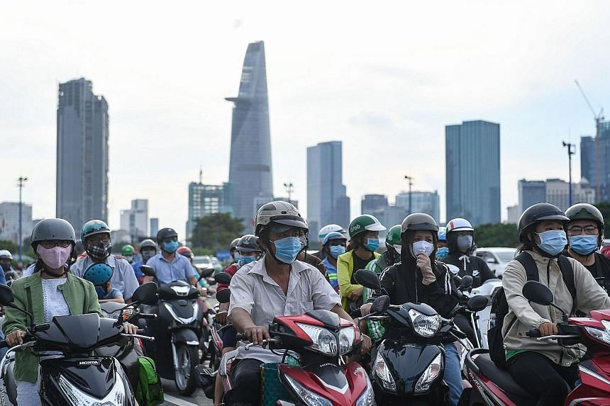 Motorists during rush hour in Ho Chi Minh City. Vietnam's economy has consistently turned in a strong performance in the past decade, growing by 5 to 7 per cent each year. Foreign investors are especially drawn by its expanding middle class, vibrant